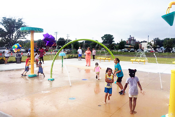 kids playing on Splash Pad at Enfield Park