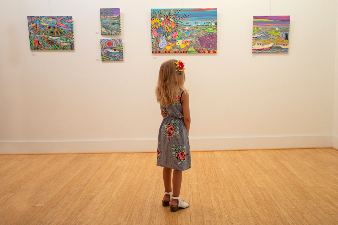 Little blonde haired Girl Admiring Art at Arts of the Albemarle