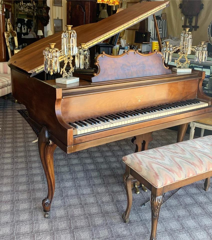 antique chandelier and piano