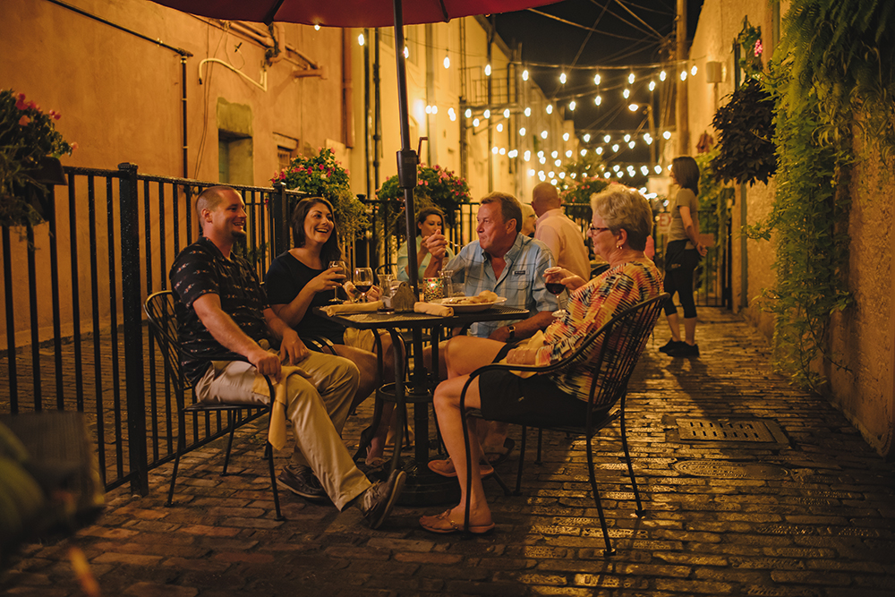 family outdoor dining at Hoppin Johnz in pailin's alley