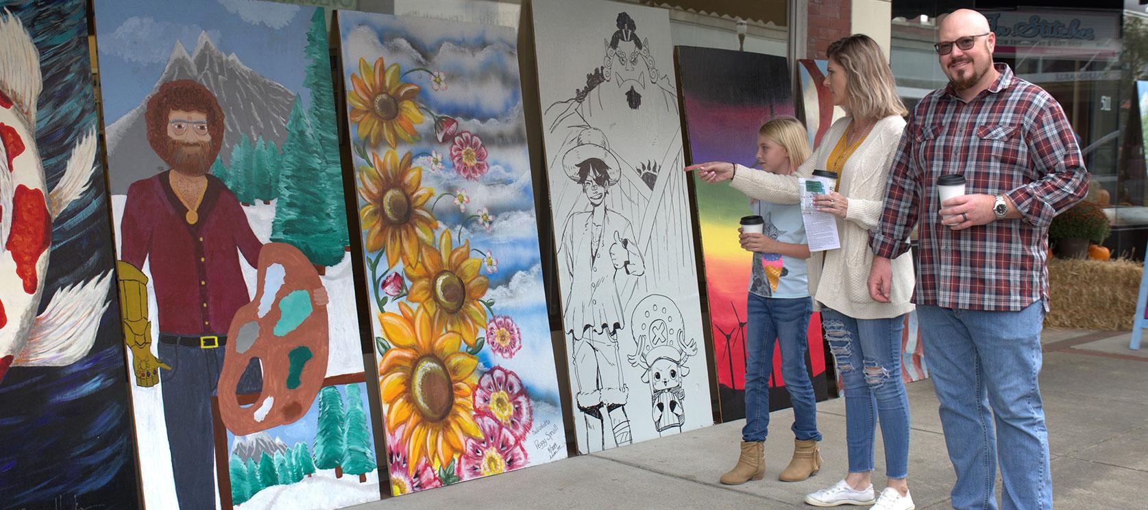 admiring street art at first friday artwalk, Elizabeth city, North Carolina