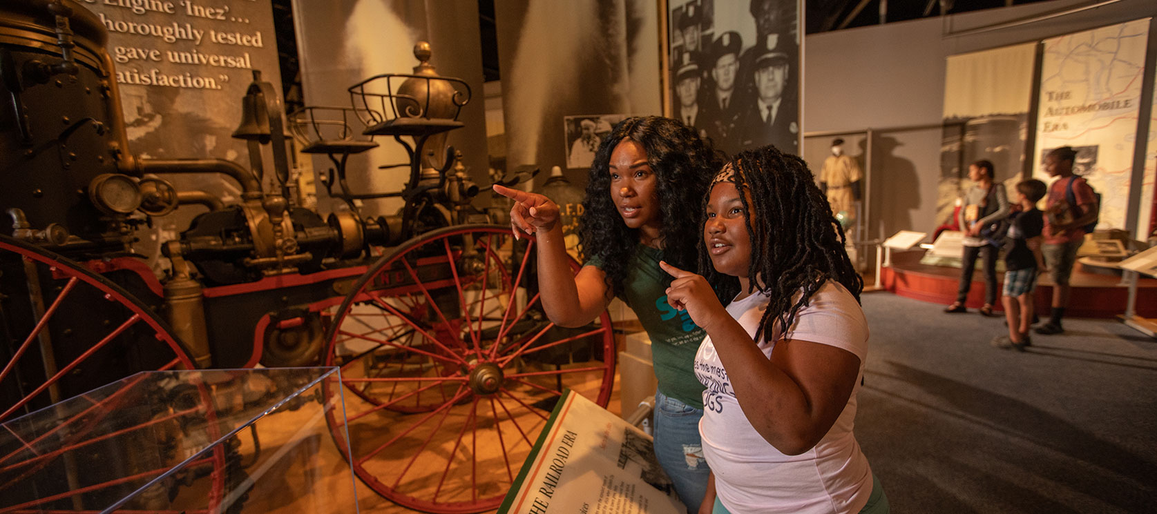 mom and daughter admiring exhibit at museum of the albemarle