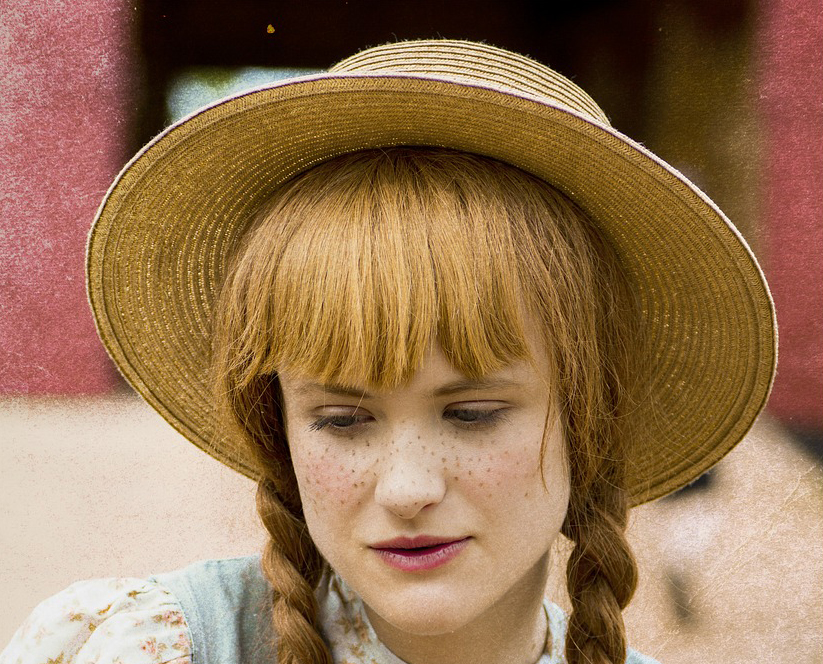 actor portraying Anne of Green Gables with hat and freckles