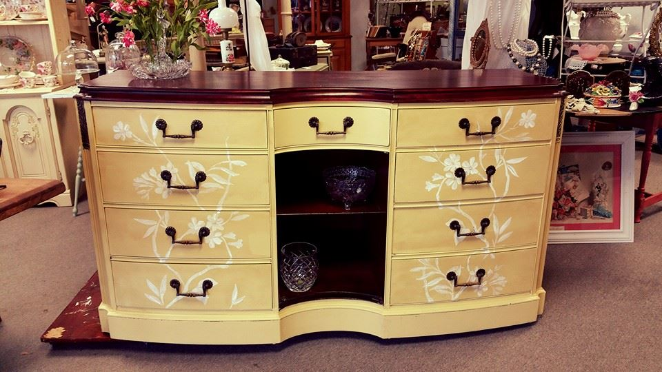 antique dresser with flower design