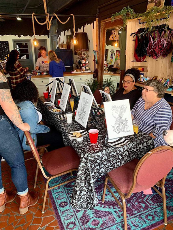 ladies painting canvas at Dear Alchemy