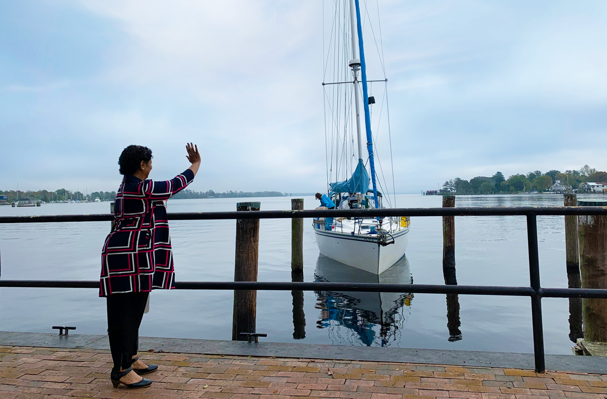mayor bettie parker of elizabeth city, nc waving at incoming boaters on the waterfront