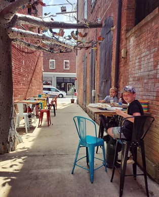 two kids eating in an artsy alleyway - Ives Alley, Elizabeth City, North Carolina