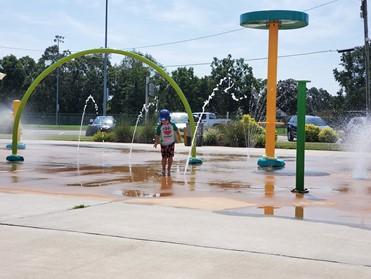 kid playing on splash pad at park in Elizabeth City, North Carolina