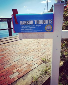 harbor thoughts mailbox with flag up and river in the background, Elizabeth City, North Carolina