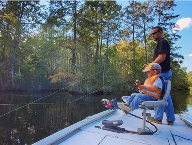 father and son fishing from boat in Pasquotank River, Elizabeth City