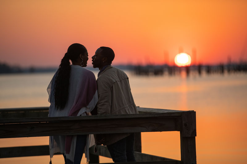 Couple enjoying the sunset at waterfront park in Elizabeth City, NC