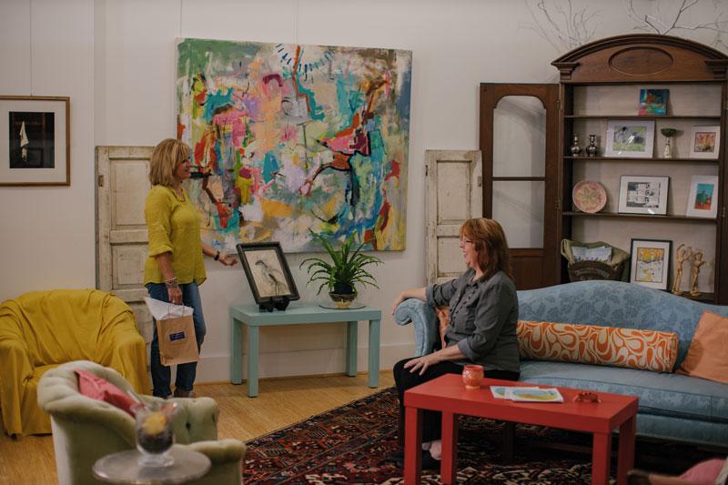 women talking and admiring art at Arts of the Albemarle, Elizabeth City NC
