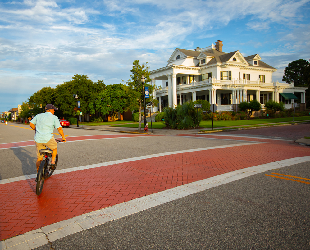 man riding bike around downtown, historic elizabeth city