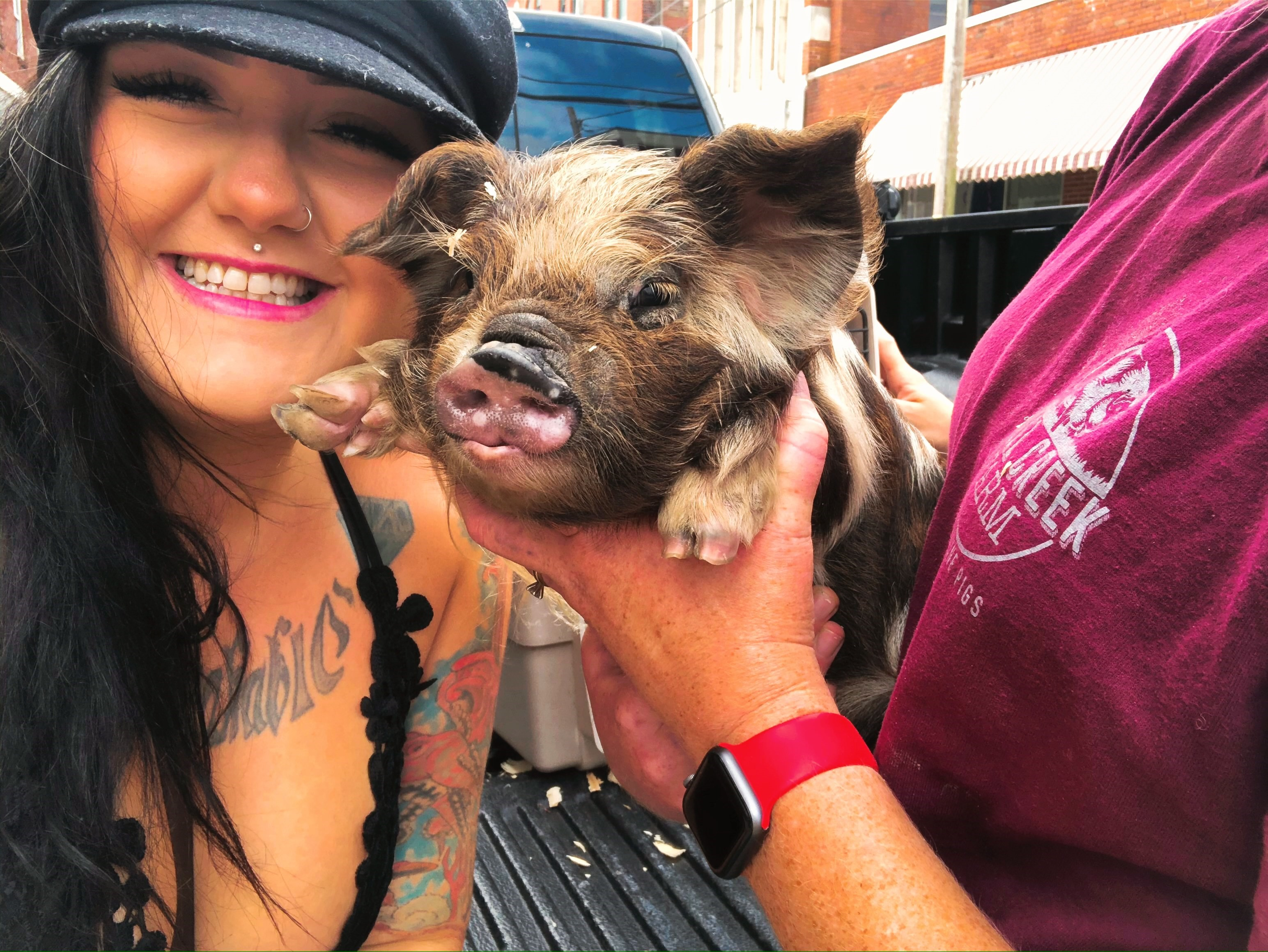 woman smiling with cute piglet