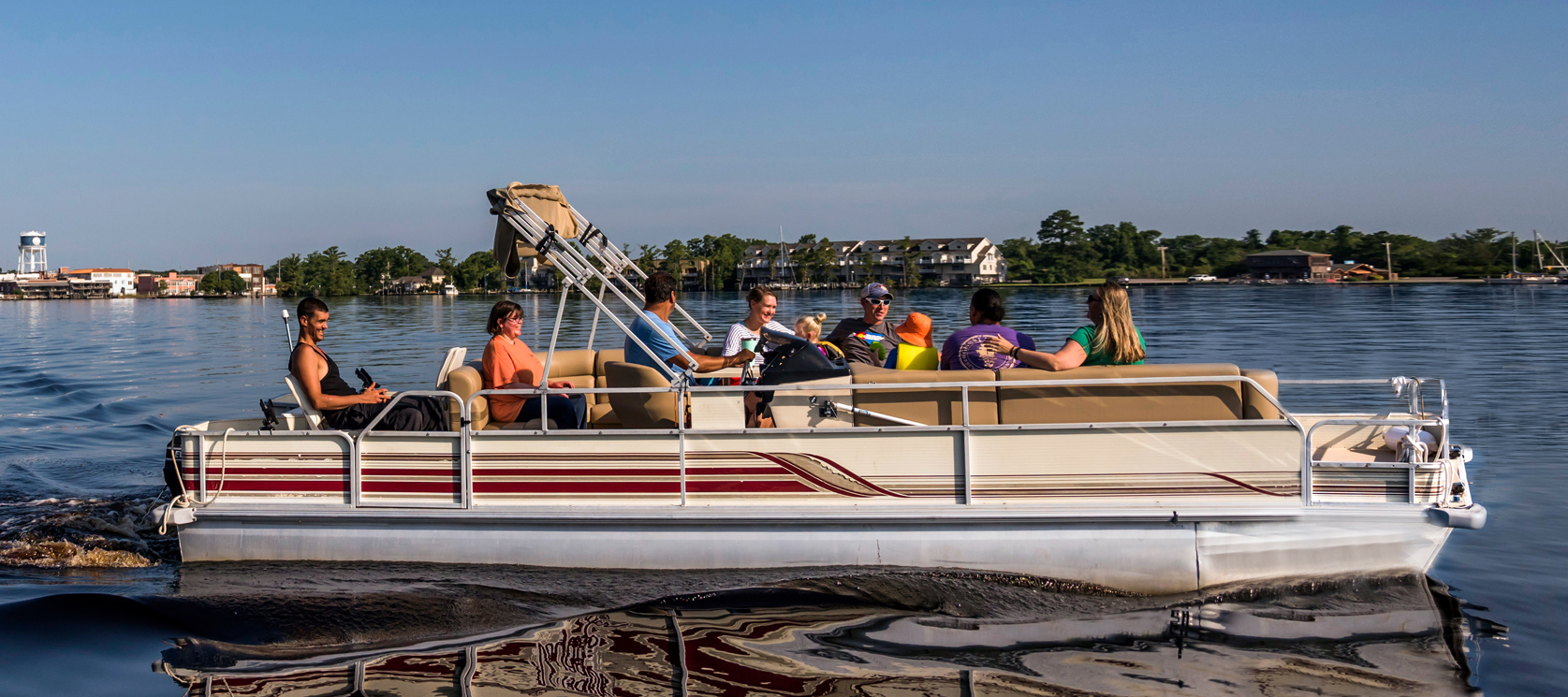 group of people riding pontoon boat on Pasquotank River in Elizabeth City NC