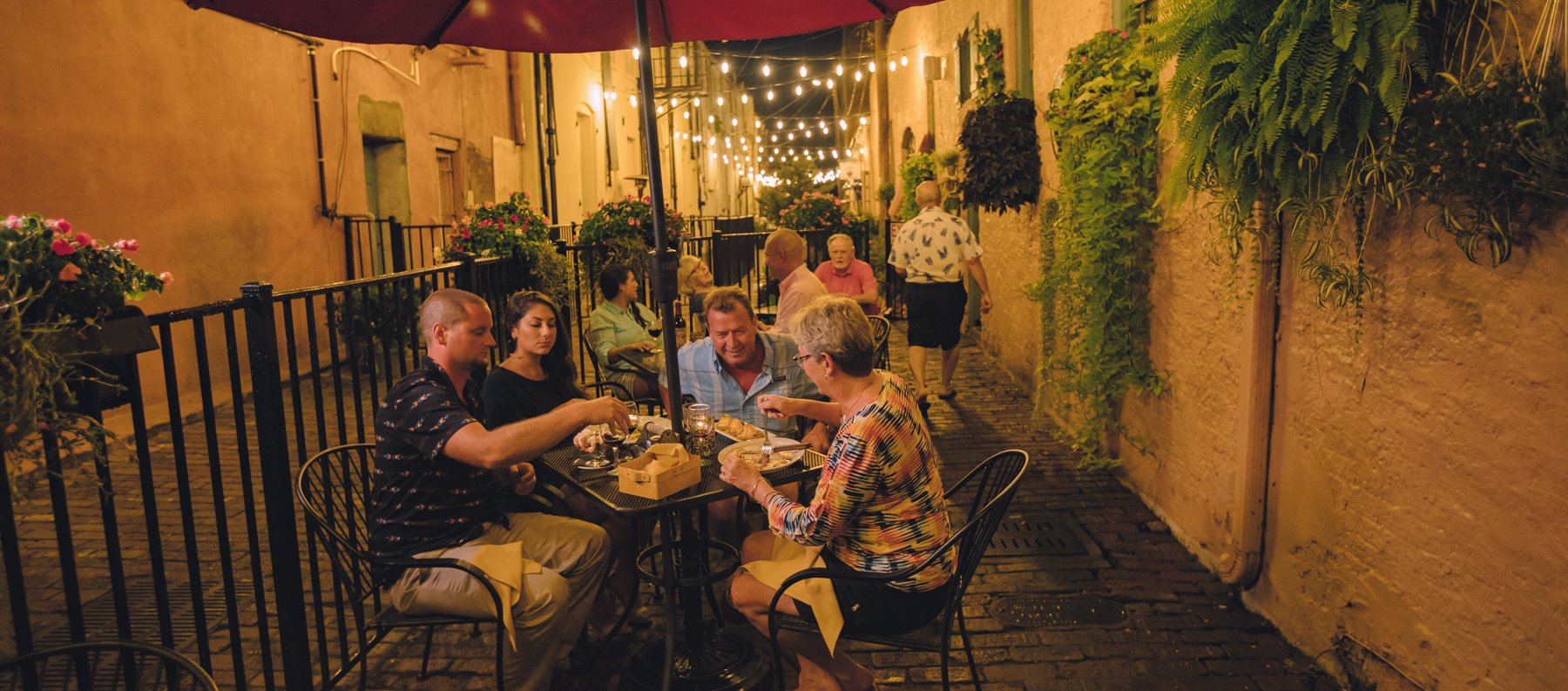 family eating dinner in enclosed outdoor dining area, downtown Elizabeth City, North Carolina
