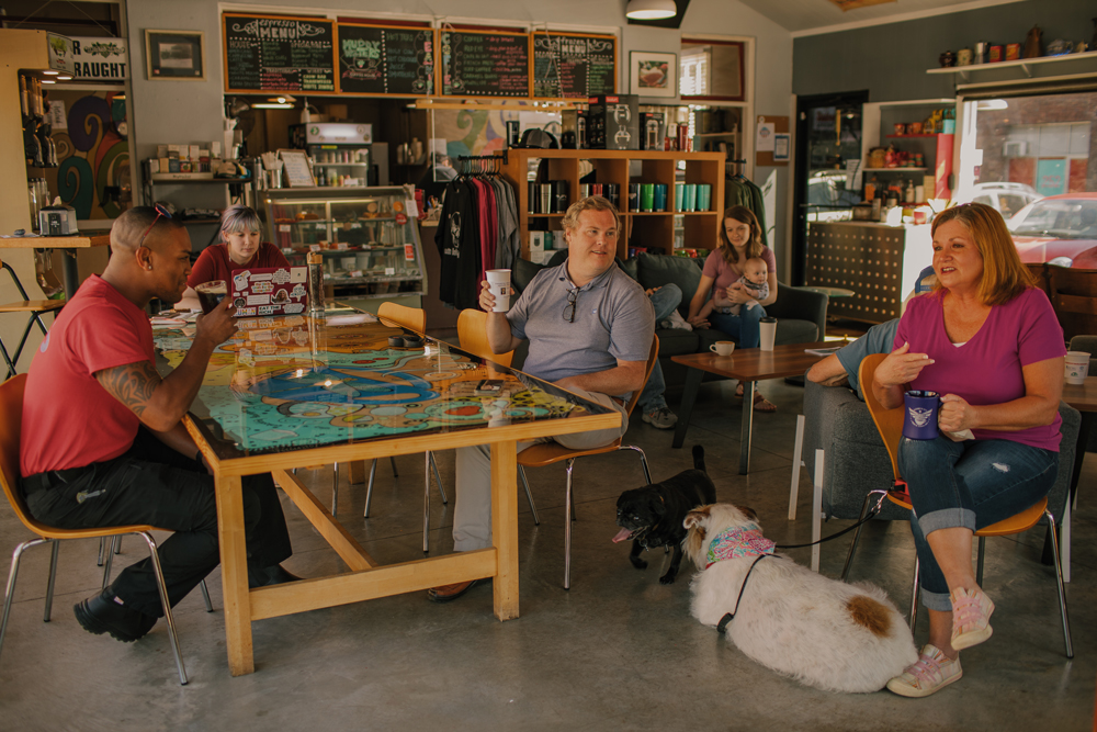 people drinking coffee and a dogs at downtown coffee shop in Elizabeth City, North Carolina