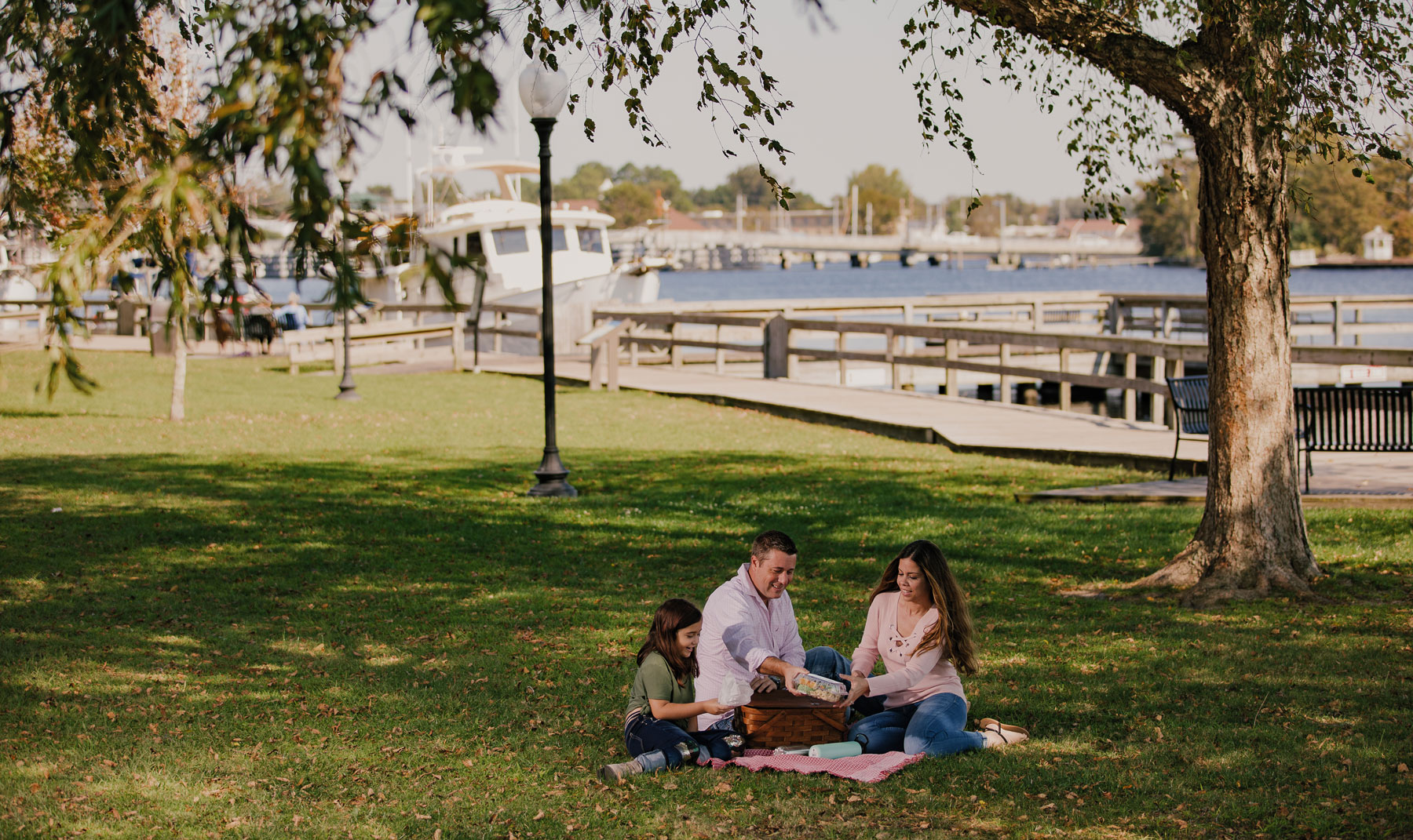 family picnic in at waterfront park