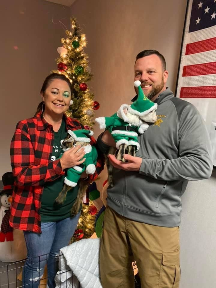Sheriff Tommy Wooten and his wife hold their dog while Christmas decorating