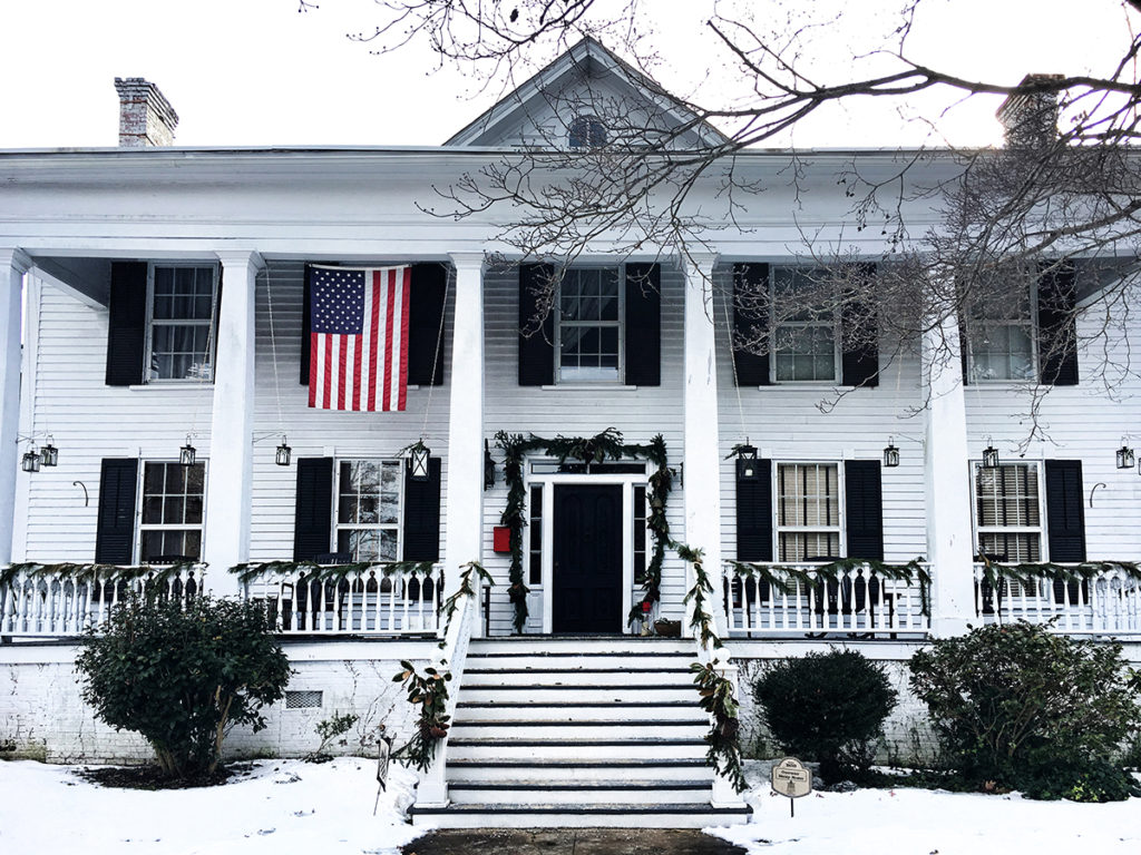 old overman-sheep house elizabeth city decoraed for christmas with american flag out front