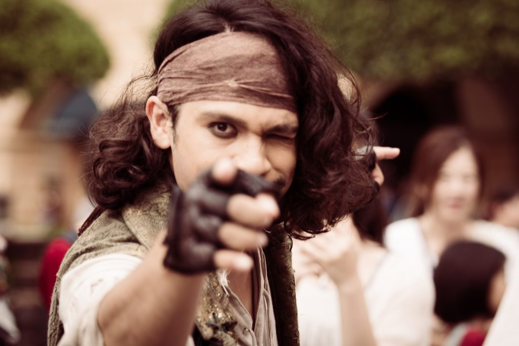 man dressed as pirate pointing at camera