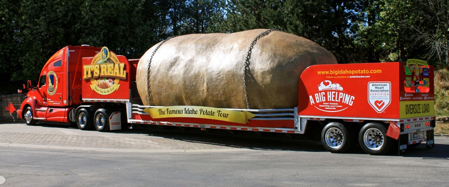 giant potato being hauled on semi-truck